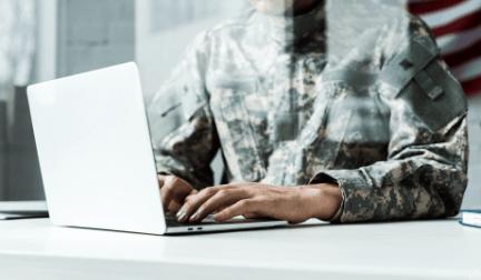 military man working at laptop